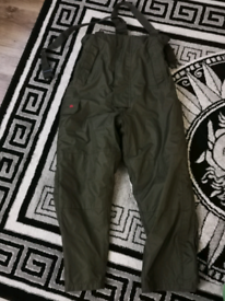 Size M Trakker thermal bib and brace fishing trousers