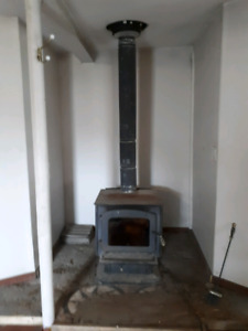 Wood stove. Complete with chimney