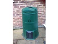 A large green compost bin