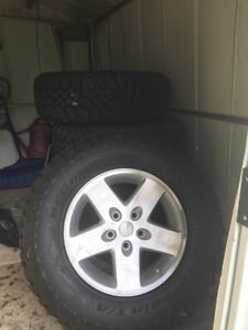 5 stock jeep wrangler complete wheels mint , never used.