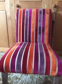 Upholstered, vintage and vibrantly coloured velvetchair