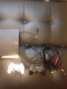 PS3 with headset, 2 controllers, and many games!