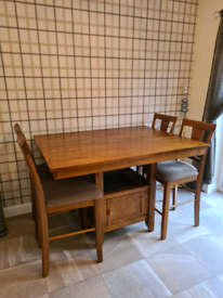 Saddle brown oak finish extendable dining table with 6 chairs