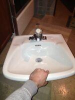 White Ceramic Sink w/ Moen Faucet
