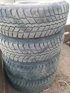 FOUR STUDDED WINTER TIRES 195/65/15