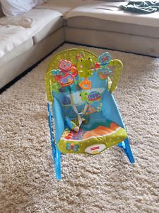 Vibrating baby rocking seat