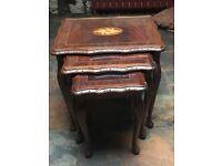 Set of three dark mahogany nested tables