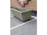STONE/CONCRETE PLANTER TLED/ BRICK EFFECT WITH GOOD DRAINAGE AND FEET