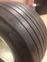 18/850-8 rib tire on 5 hole rim.