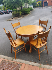 68. Tiger oak table and chairs