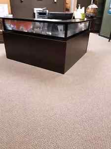 Reception desk with matching credenzas and shelving unit