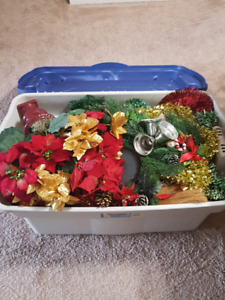 Large Tupperware full of Christmas decorations