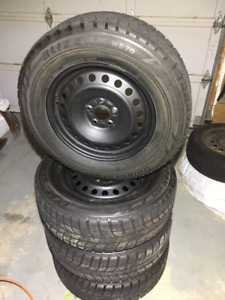 Four 225/65R16 Bridgestone Blizzak Winter Tires on Steel Rims