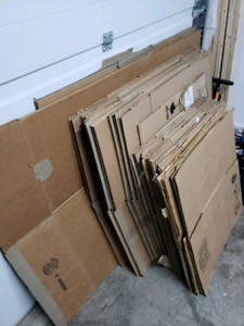 35 Moving boxes and packing paper