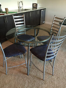 Ikea Glass round dining table and 4 metal chairs