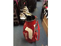 SET OF GRAPHITE IRONS 3-SW AND GOLF BAG