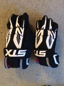 Box Lacrosse sticks, gloves, cup, ball, new condition