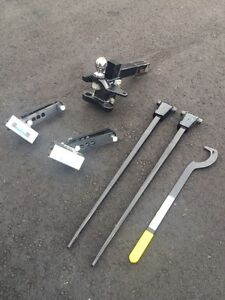 Tow hitch Reese with sway bars. Used twice!!