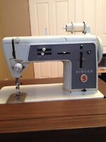 Retro Singer sewing machine in table