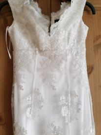 Size 6 wedding dress (never been worn)