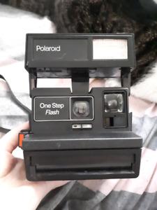 POLAROID one step flash camera.