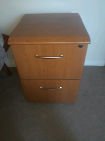 1 filing cabinet drawer and one set of drawers