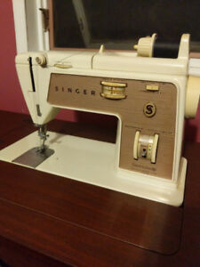 Singer sewing machine and accessories.