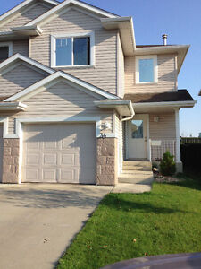 Beautiful west end single attached home in perfect location!