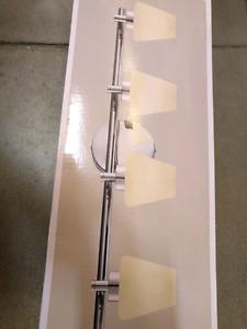 Brand new 4 light chrome finish bathroom wall light