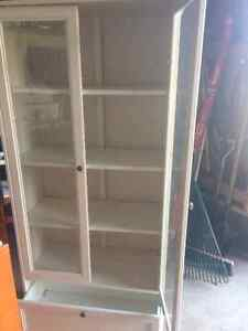 Book case with glass doors and drawer