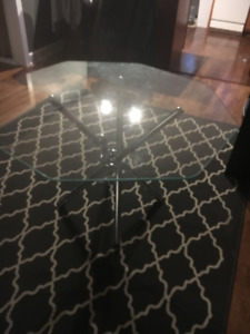 Glass and chrome dining room table.  No chairs