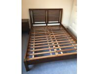 Dark wood double bed with matching chest of drawers and bedside tables