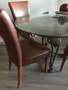 Glass Table With Wrought Iron Base and Four Chairs