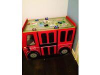 Kids play inside bus.