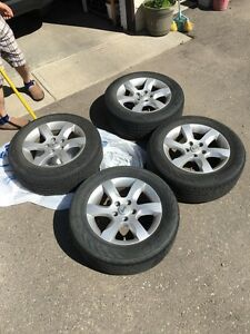 Stock Nissan wheels W/ summer tires