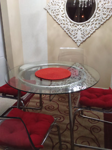 IKEA round glass top dining table, chairs are not included, free