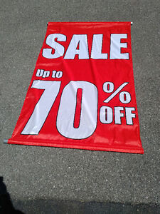 store window sale signs