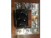 PS3 console with 9 games and 3 controllers
