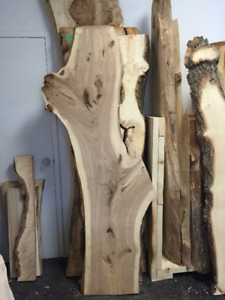 Live edge slabs bar tops and fire place mantles