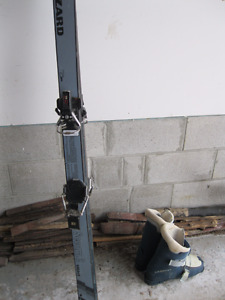 FOR SALE: Adult's pair of downhill skis and boots (men's size 9)