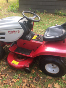White Outdoor lawn tractor.