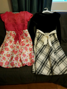 NEW with tags. Girls dresses size 10-14. Both dresses for $20.