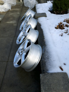 4 Silver Factory Alloy Rims from Toyota Matrix 2005.