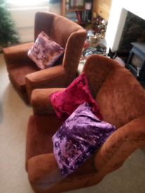 Two vintage, chocolate brown armchairs