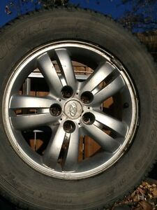 Set of four Hyundai rims and winter tires