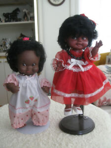 TWO ADORABLE BLACK DOLLS DRESSED in ALL THEIR FINERY