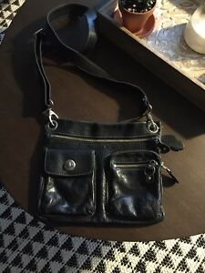 All leather black Roots purse.