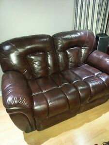 Brown Bonded Leather loveseat., both sides are power recliner,