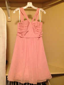 Two light pink bridesmaid dresses