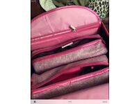 Pink ghd straighteners and travel hair dryer
